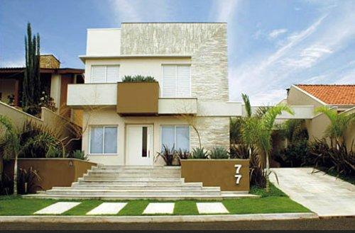 frentes de casas bonitas una vivienda con una amplia entrada